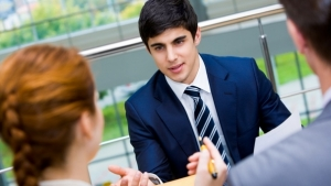 Portrait of confident businessman sharing his ideas with associates at meeting